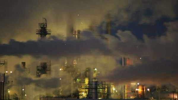 Stationary shot of factory smoke stacks during the night in Wyoming. Royalty-free stock video