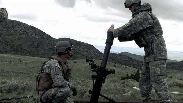 Clip of two soldiers firing mortar. Green Beret United States Army Special Forces. Royalty-free stock video