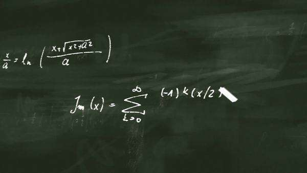 Animation presents mathematical formulas writing on a green board by moving chalk. Royalty-free stock video