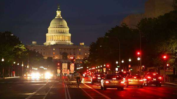 Timelapse shot of United States Capitol building night view from  Pennsylvania Avenue with car lights, Washington DC Royalty-free stock video