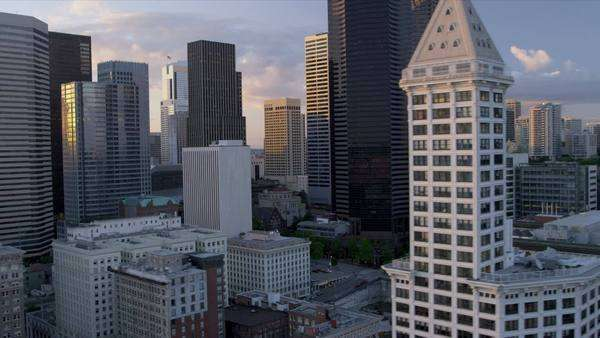 Aerial sunset view Smith Tower Columbia Center Downtown Seattle Business Center, Elliott Bay, Puget Sound, Pacific Northwest, USA, RED EPIC Royalty-free stock video