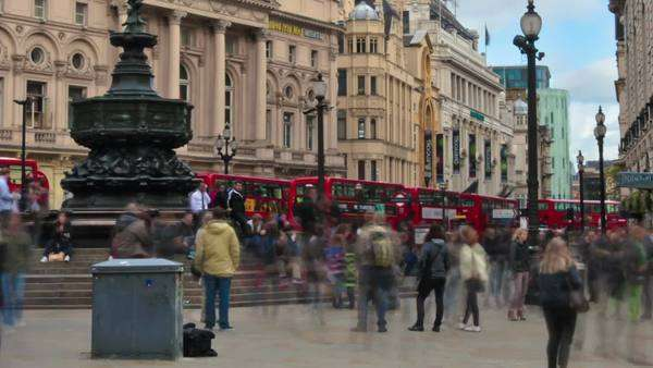 Timelapse shot in the afternoon at Piccadilly Circus as people and cars go by in London, England. Filmed in October 2011. Cropped. Royalty-free stock video