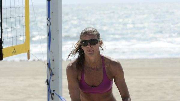 Close-up of a female beach volleyball player hand setting the ball in a bikini Royalty-free stock video