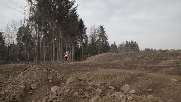 Motocross biker carving turn in slow motion, wide shot Royalty-free stock video