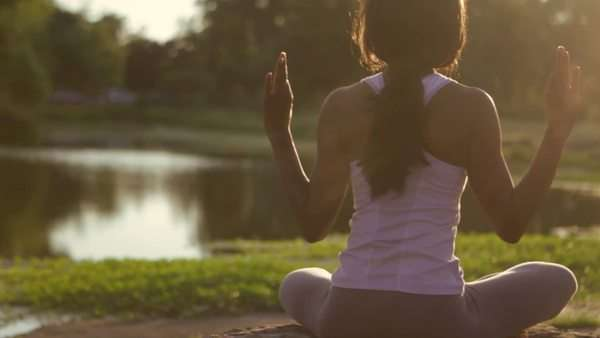 Sitting black woman doing yoga Royalty-free stock video