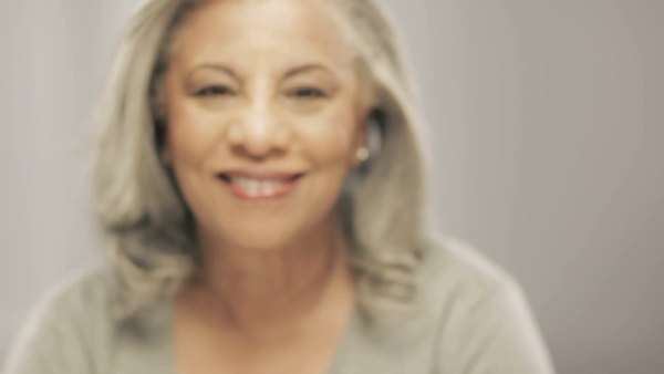 Older black woman with gray hair smiling at camera Royalty-free stock video