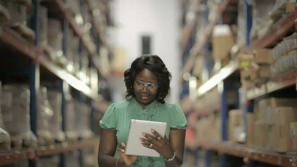 Black woman in warehouse using digital tablet Royalty-free stock video
