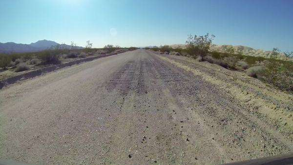 Driving along gravel road through desert, Barstow, California, USA Royalty-free stock video