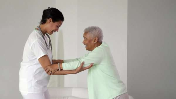 Nurse helping senior woman to walk Royalty-free stock video