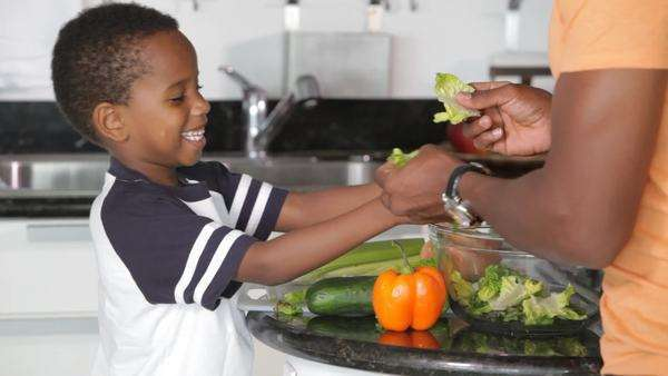 African American father with son preparing salad Royalty-free stock video