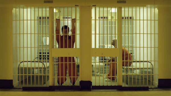 Two prisoners do some exercises in their cells Royalty-free stock video