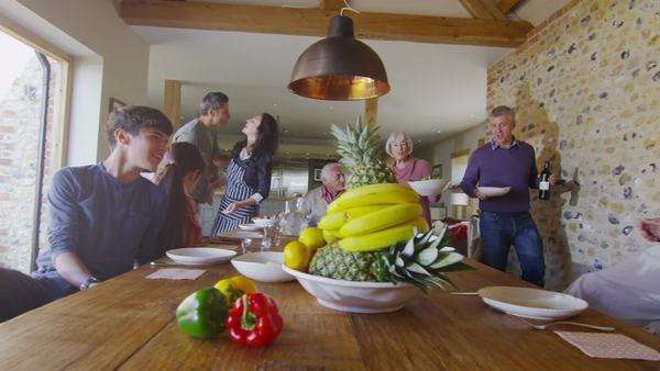 Happy extended family group sit down to enjoy a meal together at home Royalty-free stock video