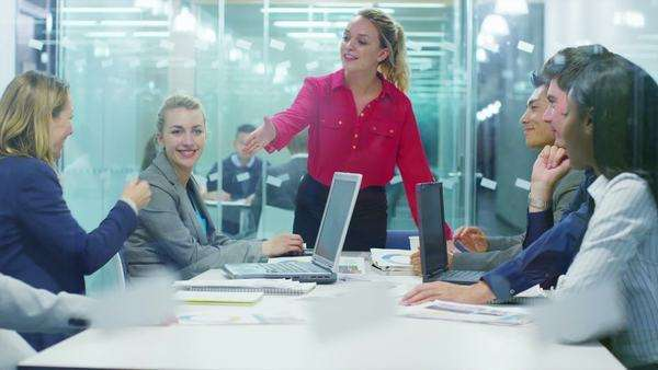 Attractive young business team in a meeting in modern city office Royalty-free stock video