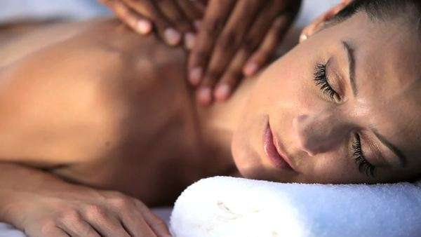 Sophisticated lady having massage treatment at a luxury health and beauty spa. Royalty-free stock video