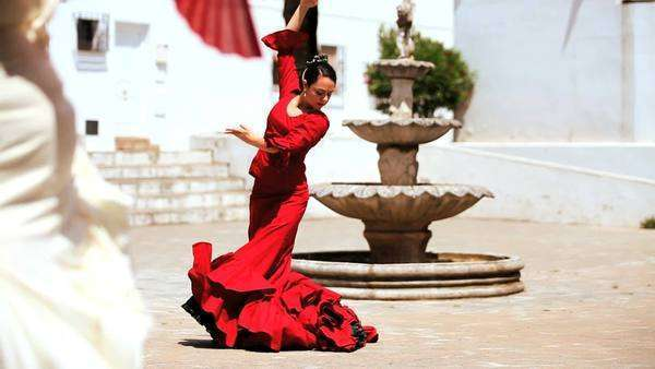 Two females dancing traditional flamenco in town square in Seville, Spain . Royalty-free stock video