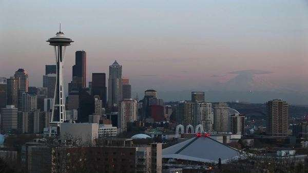 Seattle's landmark Space Needle dominates the city's skyline during the golden hour. Royalty-free stock video