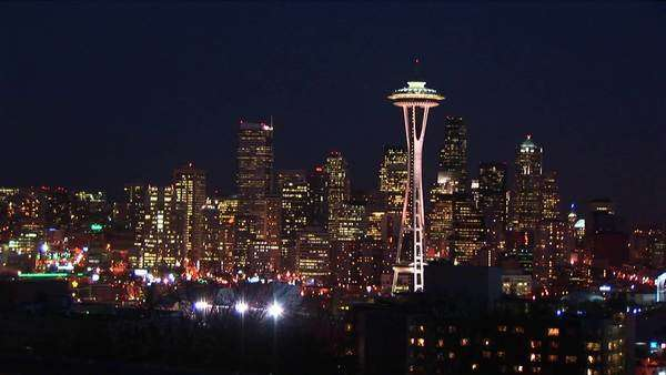 Seattle glitters at night, with the landmark Space Needle a crowning jewel. Royalty-free stock video