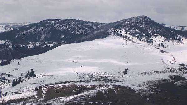 Snow covers a mountain's broad slope. Royalty-free stock video