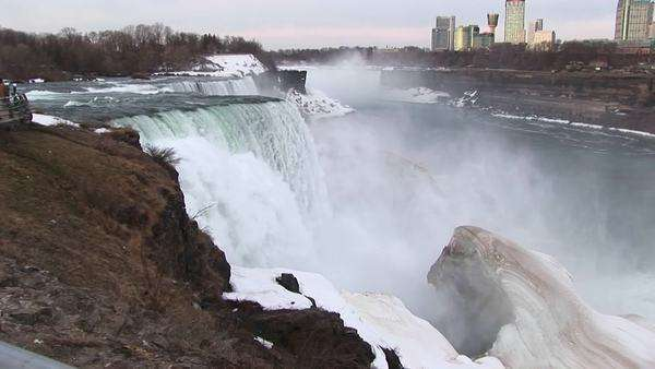 A longshot of Niagara Falls in winter with tourist hotels in the distance. Royalty-free stock video