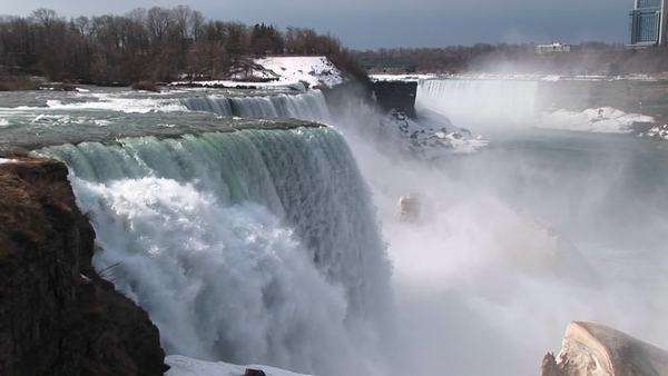 A look from the top of Niagara Falls to the snow and mist in the distance. Royalty-free stock video
