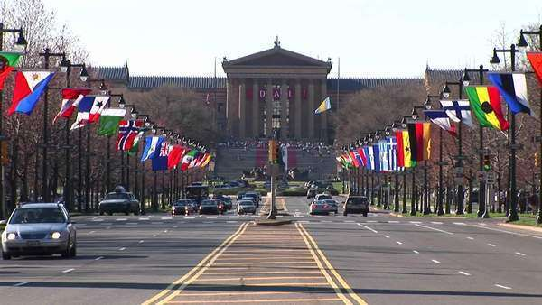 The flag-lined Benjamin Franklin Parkway leads up to the famous steps of the Philadelphia Museum of Art. Royalty-free stock video