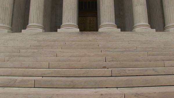 Stone steps lead to the columned entrance to the Supreme Court. Royalty-free stock video