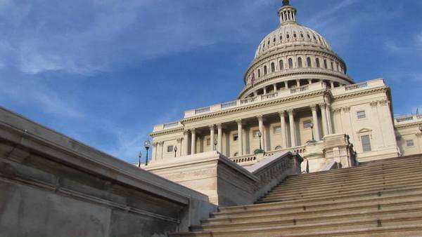 Looking up the steps of U.S. Capitol building for a view of the portico and dome. Royalty-free stock video