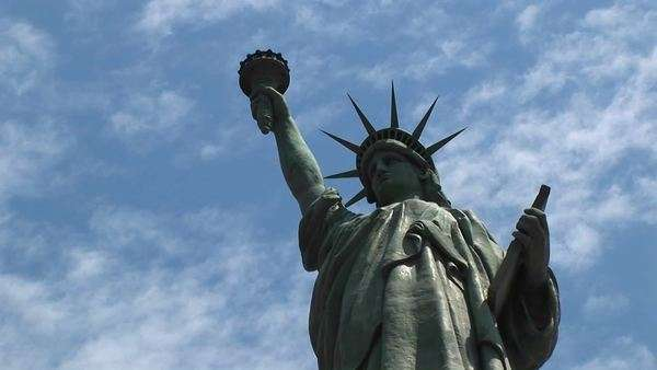 The Statue of Liberty proudly raises her touch. Royalty-free stock video