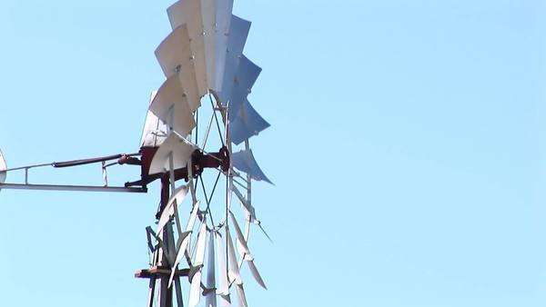 Medium-shot of windmill blades spinning in the wind. Royalty-free stock video