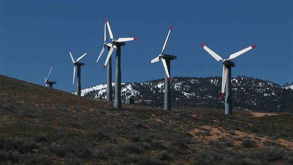 Long-shot of several wind turbines generating power at Tehachapi, California. Royalty-free stock video
