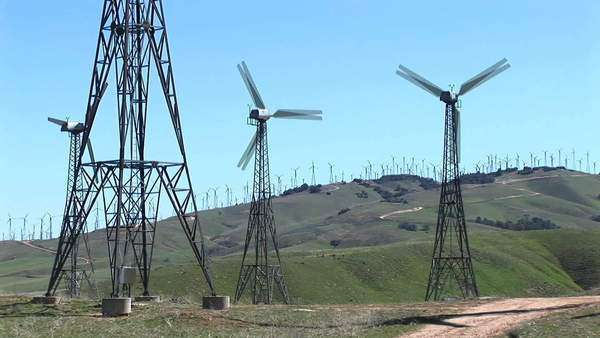 Medium shot of four wind turbines generating power at Tehachapi, California. Royalty-free stock video