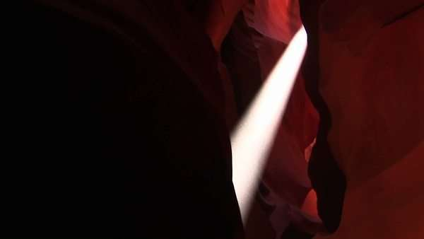 Medium-shot of a light beam illuminating an interior space in Antelope Canyon, Arizona. Royalty-free stock video