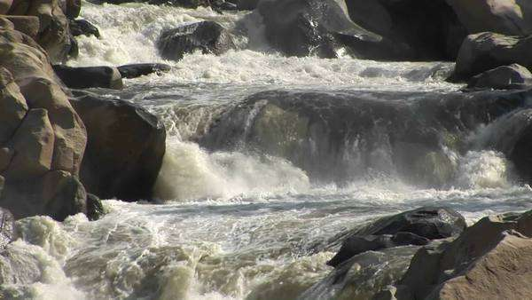 Medium shot of the Kern River rapidly decending a small falls in the Sierra Nevada Mountains. Royalty-free stock video
