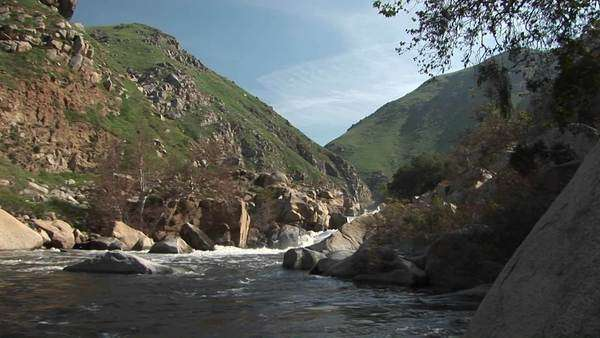 Wide shot of the Kern River flowing from a canyon in the Sierra Nevada Mountains. Royalty-free stock video