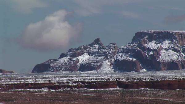Medium-shot of Arizona desert cliffs dusted with light snow. Royalty-free stock video