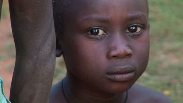 Orphans display sadness on their faces at a camp in Uganda, Africa. Royalty-free stock video