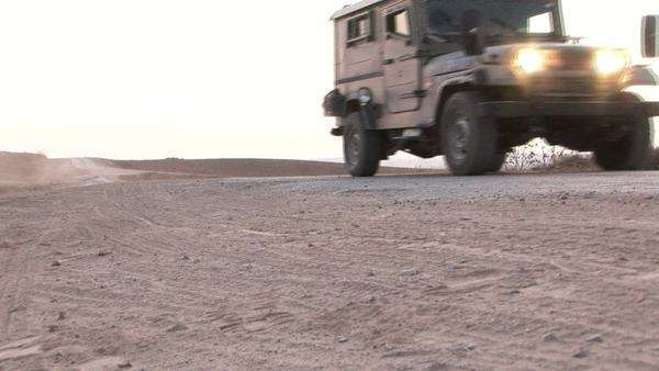 An Israeli army patrol moves along a border region. Royalty-free stock video