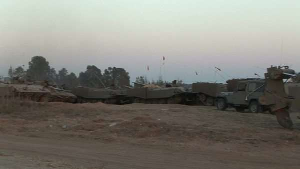 Armored vehicles wait at an Israeli army staging post at the Gaza strip border. Royalty-free stock video