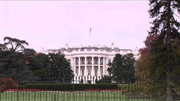 An American flag waves on the roof of the White House in Washington, D.C. Royalty-free stock video