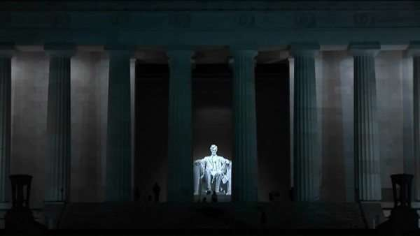 Tourists wander through the Lincoln Memorial at night. Royalty-free stock video