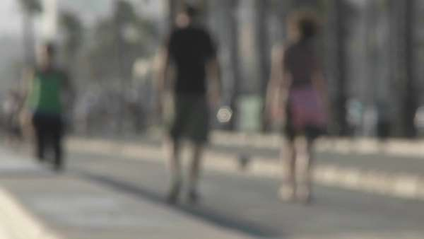 An intentionally blurred shot of pedestrians walking near Santa Monica, California. Royalty-free stock video