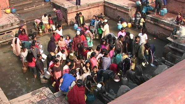 Large group of Nepalese waiting to get drinking water in Kathmandu Royalty-free stock video