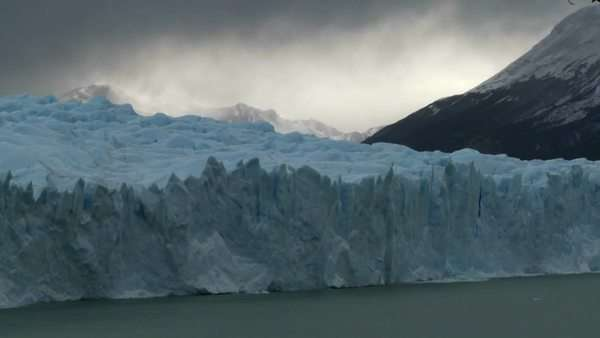 Timelapse of clouds moving across a glacier. Royalty-free stock video