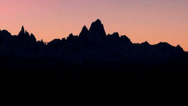 The remarkable mountain range of Fitzroy in Patagonia, Argentina silhouetted at dusk. Royalty-free stock video