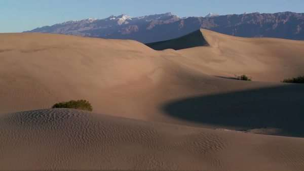 A telephoto shot across the desert dunes at Death Valley. Royalty-free stock video