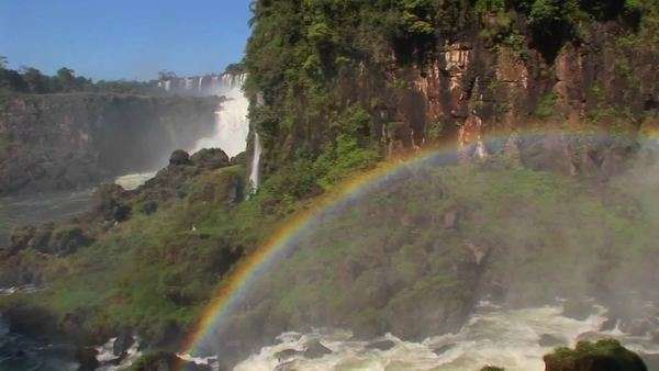 Pan across a rainbow at Iguacu Falls. Royalty-free stock video