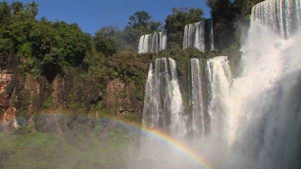 Iguacu Falls with rainbow in foreground. Royalty-free stock video