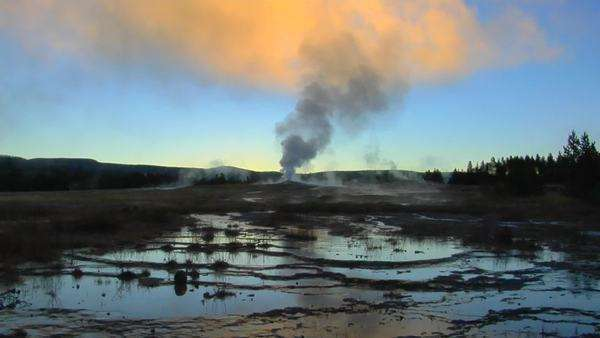 A geyser sends steam into the sky at Yellowstone National Park. Royalty-free stock video