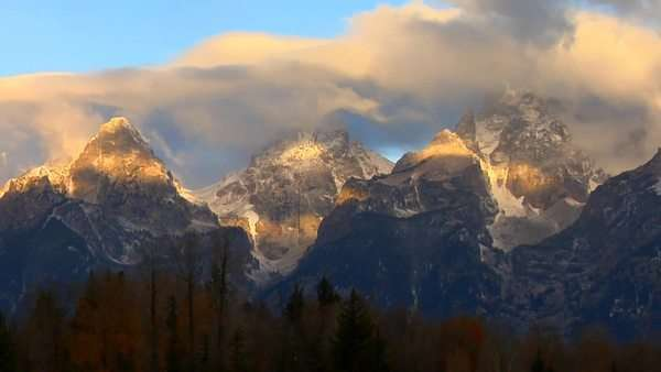 Clouds move across the Grand Teton mountain range. Royalty-free stock video