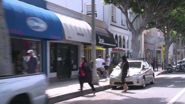 A vehicle drives through downtown Santa Monica, California. Royalty-free stock video